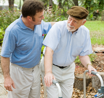Direct Care Worker assisting senior with ambulation